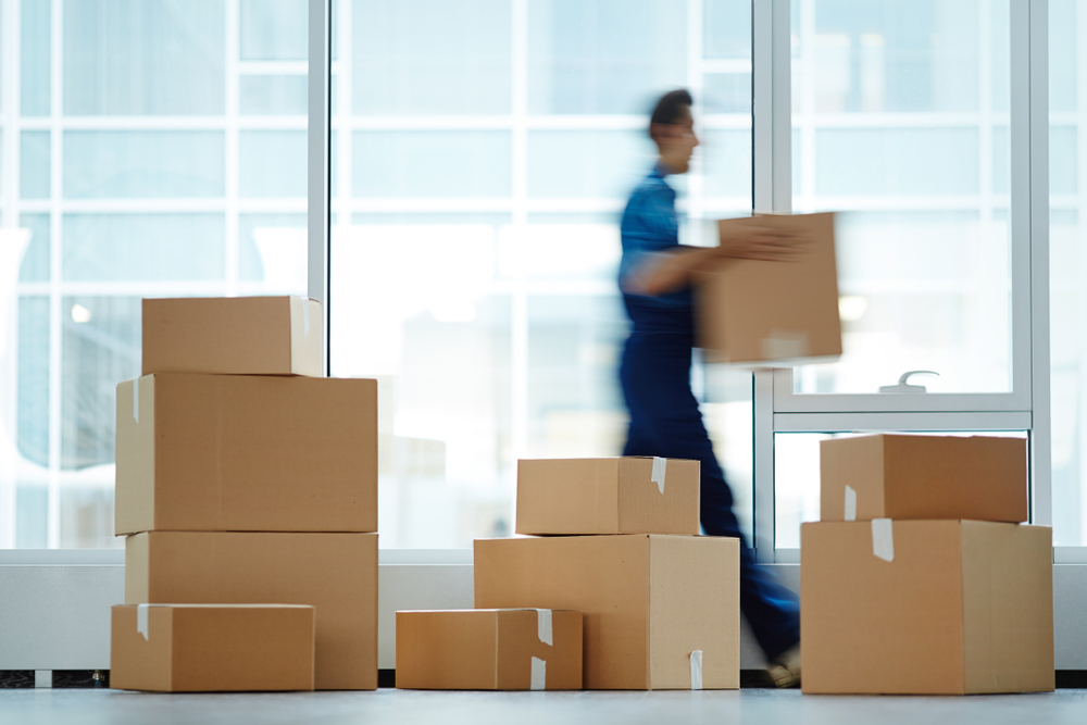 blurred man moving boxes